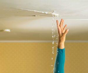 water leaking from ceiling under bathroom