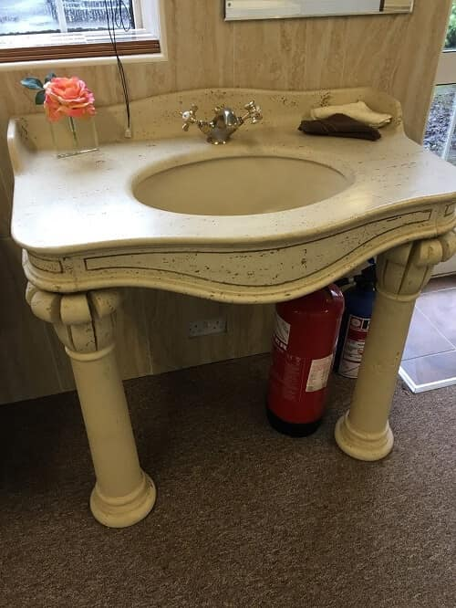 bathroom sink with legs