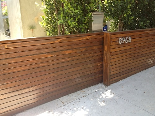25 naturally stunning wooden driveway gate design ideas for Wooden sliding driveway gates