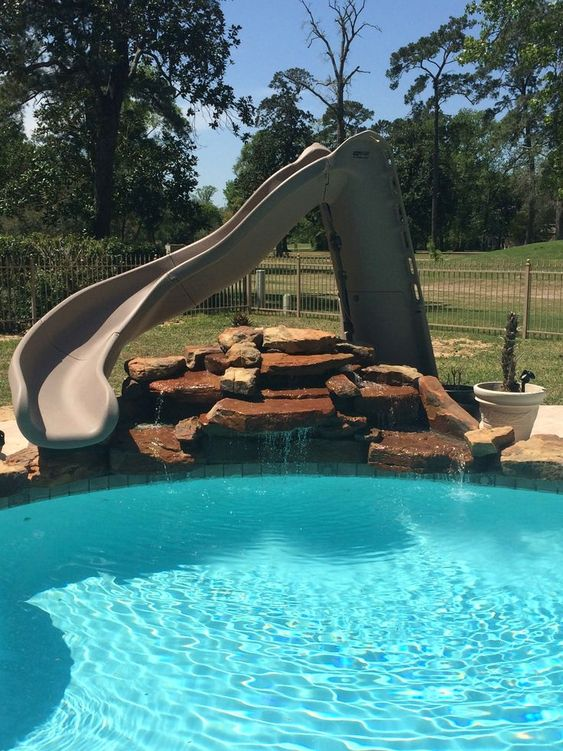 Swimming Pool with Slides: Chic Earthy Design