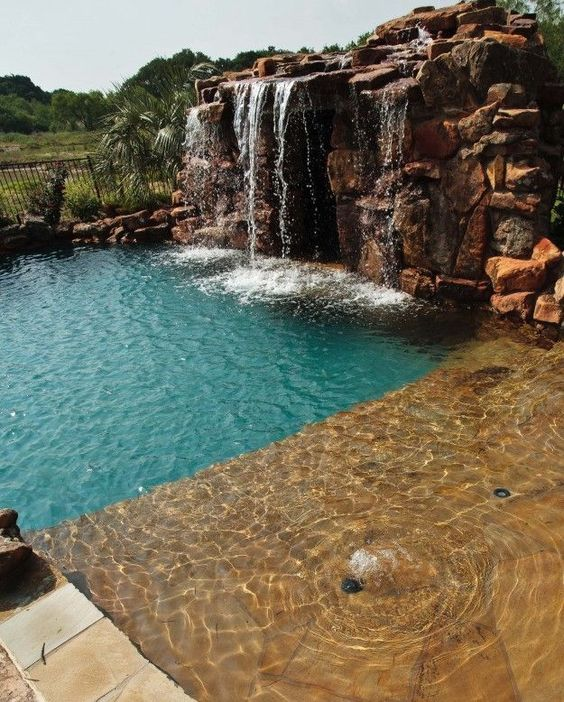 swimming pool with waterfalls 15