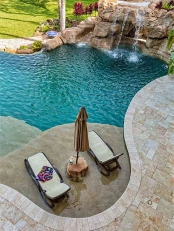 swimming pool with waterfalls 20