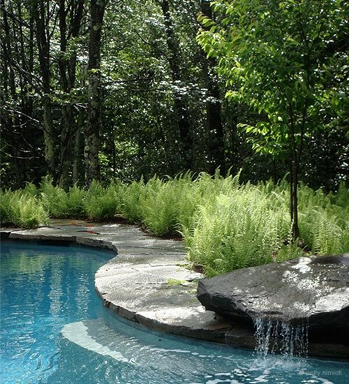 swimming pool with waterfalls 21