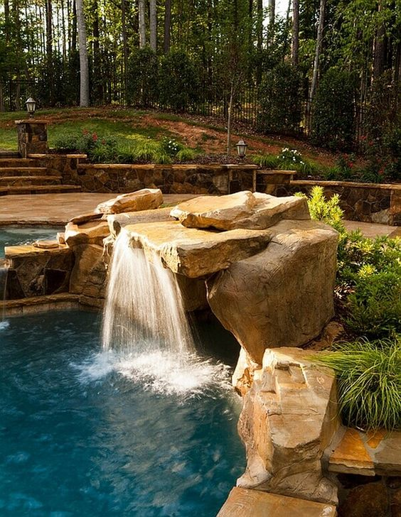 swimming pool with waterfalls 22