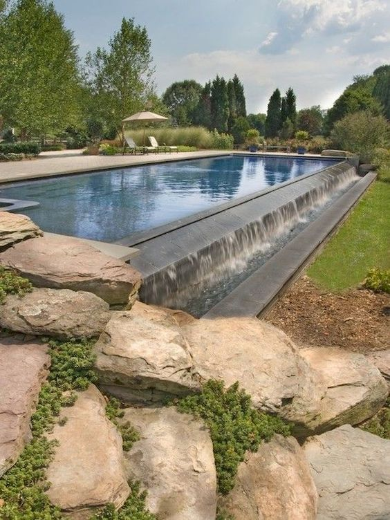 swimming pool with waterfalls 25