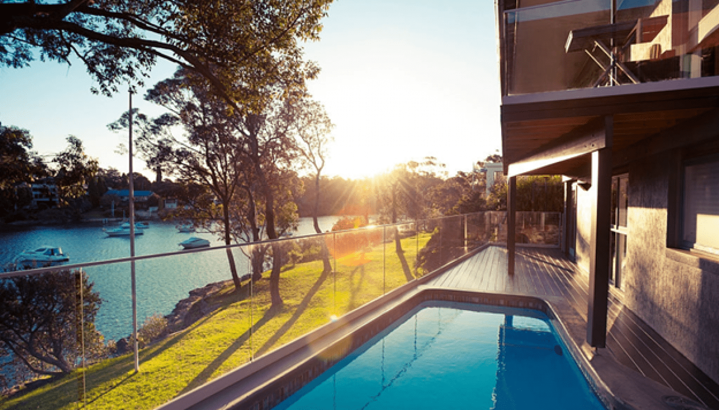 Which Pool Fencing is ideal for luxury homes: Glass Fencing vs. Metal Fencing?